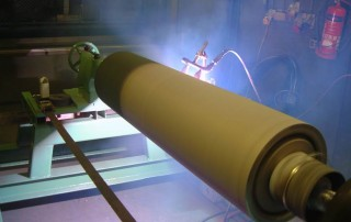 thermal spraying of high friction coatings